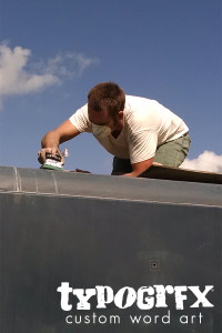Jackson sanding on the roof of the truck.