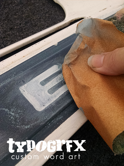 Sanding the individual letters on the grill - one of my favorite features of the whole truck